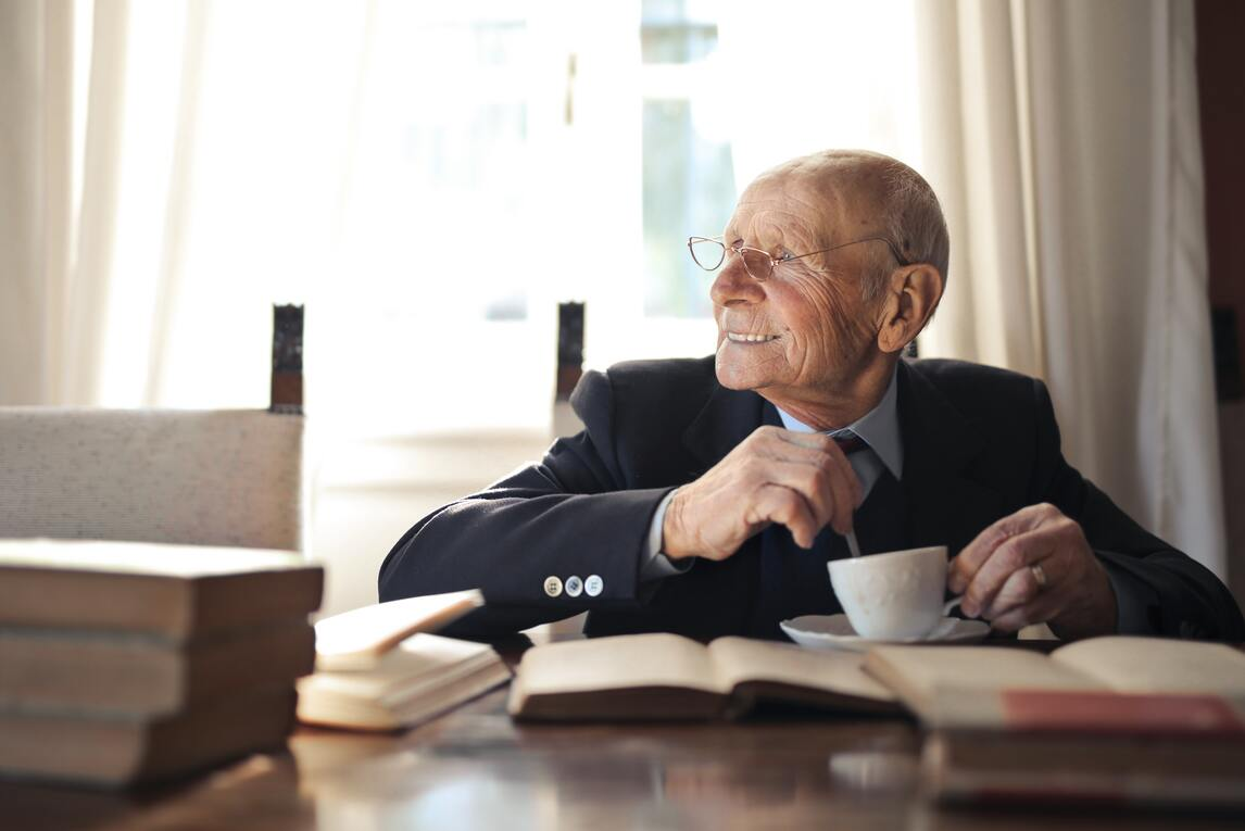 Hapy and healthy elderly gentleman at home